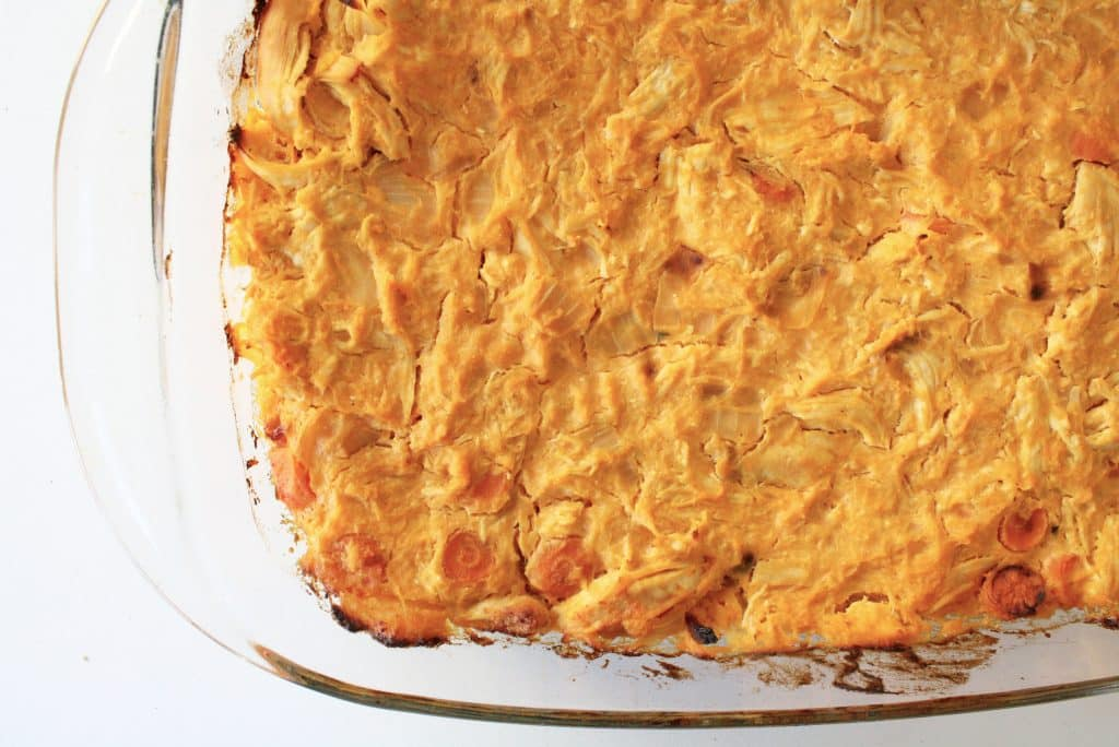 buffalo chicken casserole close on a deep glass baking dish