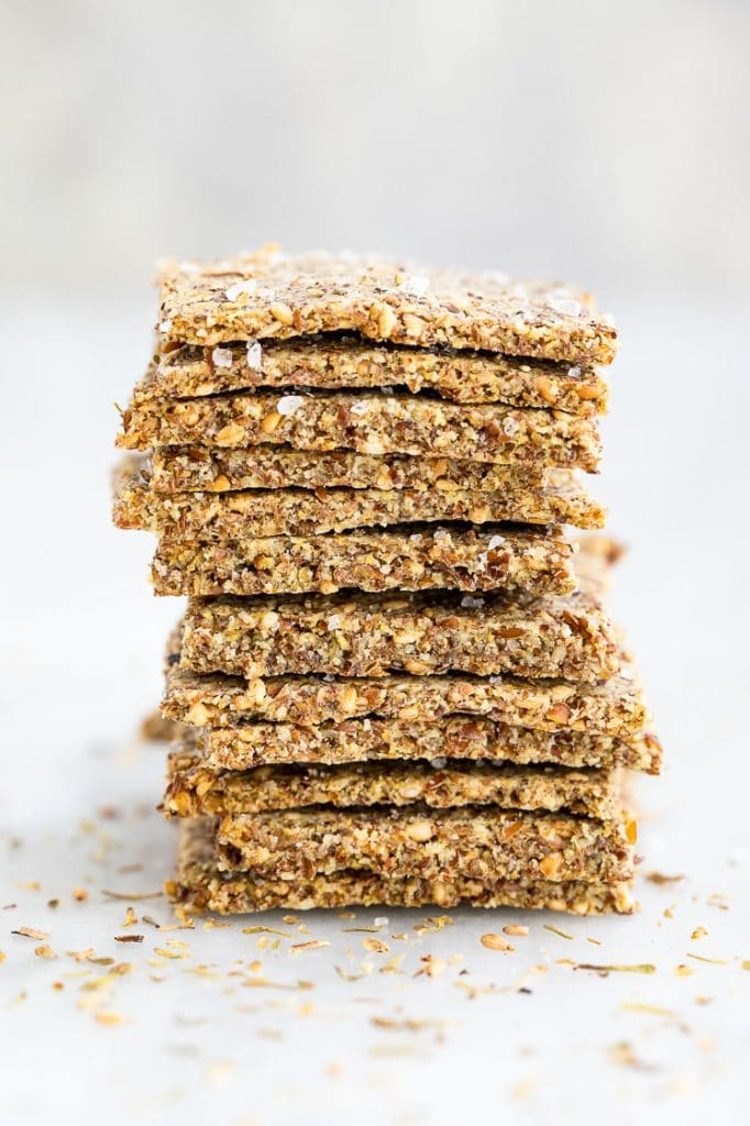 a stack of multi grain low carb crackers