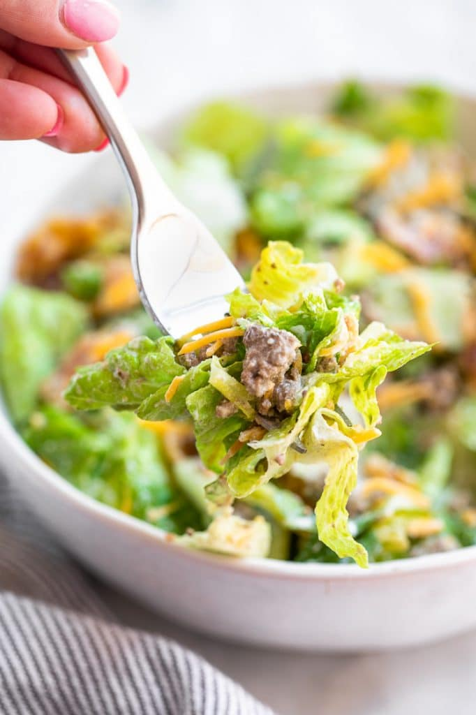 Keto Bacon Cheeseburger Salad eaten with a fork