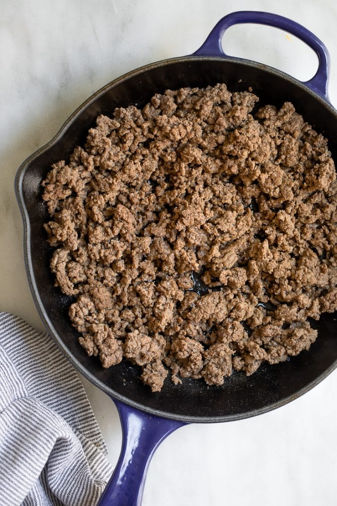 ground beef cooked in a cast iron skillet