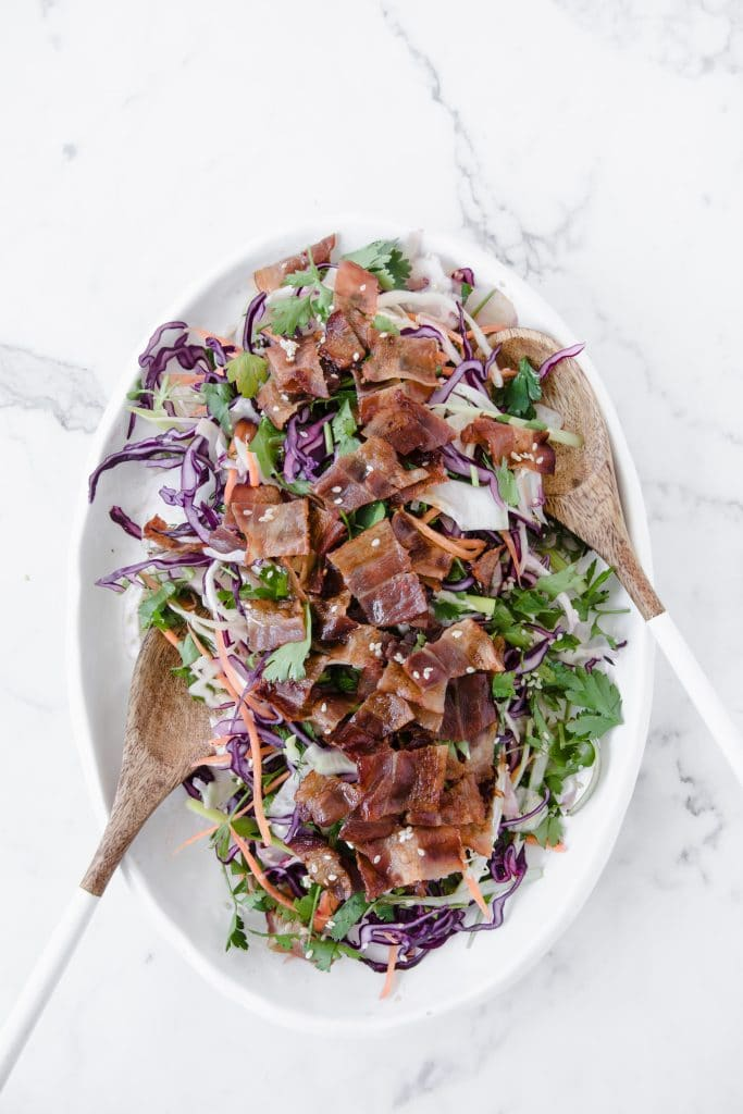 keto bacon salad with wooden salad serving spoons