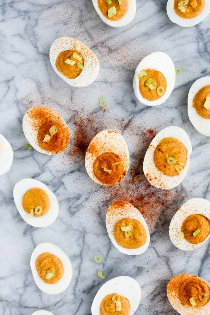 overhead-shot-of-buffalo-deviled-eggs-on-marble-board
