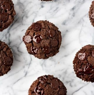 overhead-close-up-shot-on-marble-baking-board-of-Low-Carb-Triple-Chocolate-Zucchini-Muffins