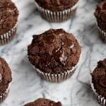 45-degree-angle-shot-on-marble-baking-board-of-Low-Carb-Triple-Chocolate-Zucchini-Muffins