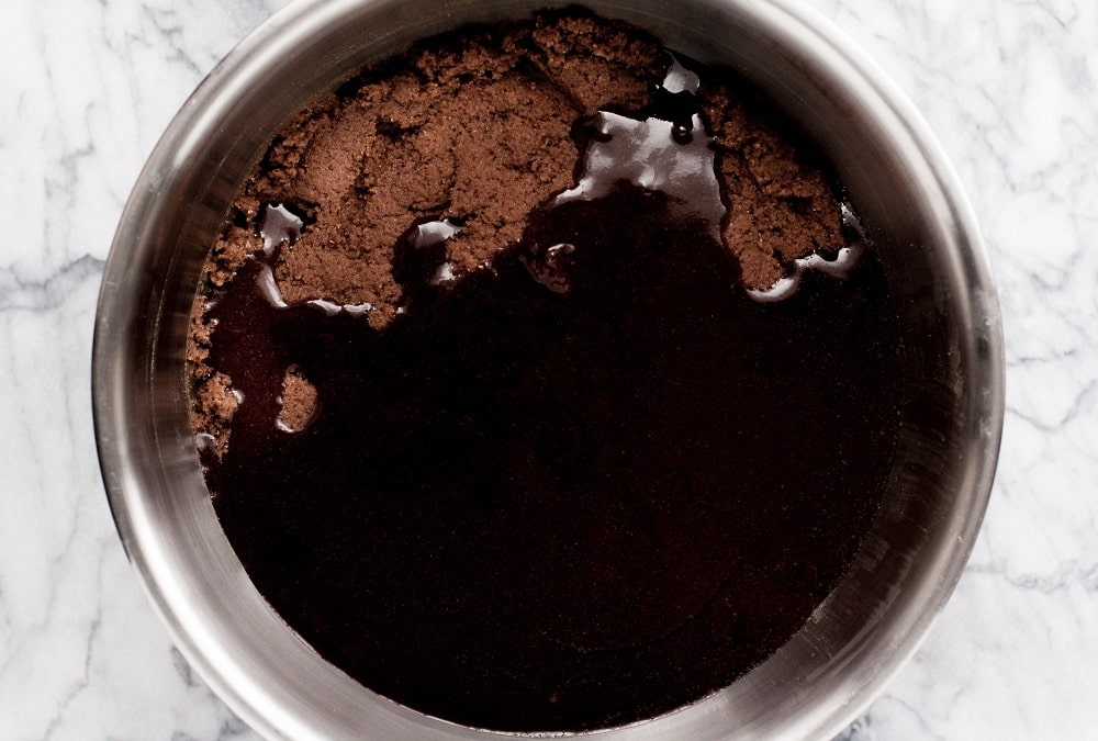 melted-chocolate-in-bowl-with-mixed-ingredients-for-Low-Carb-Triple-Chocolate-Zucchini-Muffins