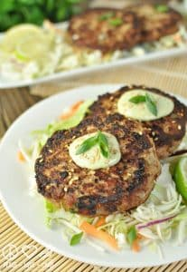 2 servings of asian tuna cakes with some salad