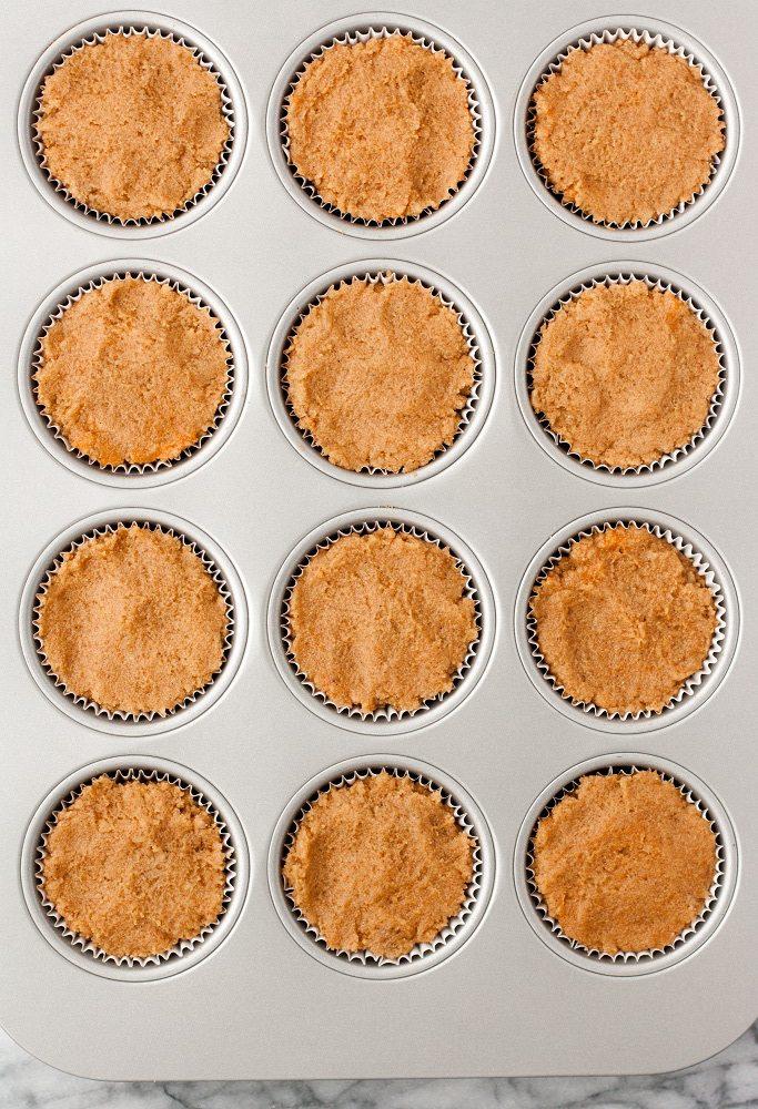 overhead shot of cream cheese pumpkin muffins batter in muffin tin