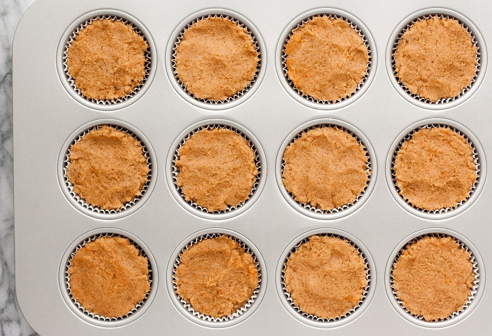overhead-shot-of-Cream-Cheese-Pumpkin-Muffins-dough-in-muffin-tin-on-marble-board