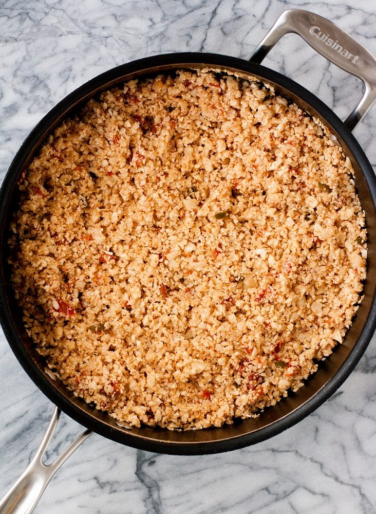 mexican-cauliflower-rice-in-black-pan-on-marble-board
