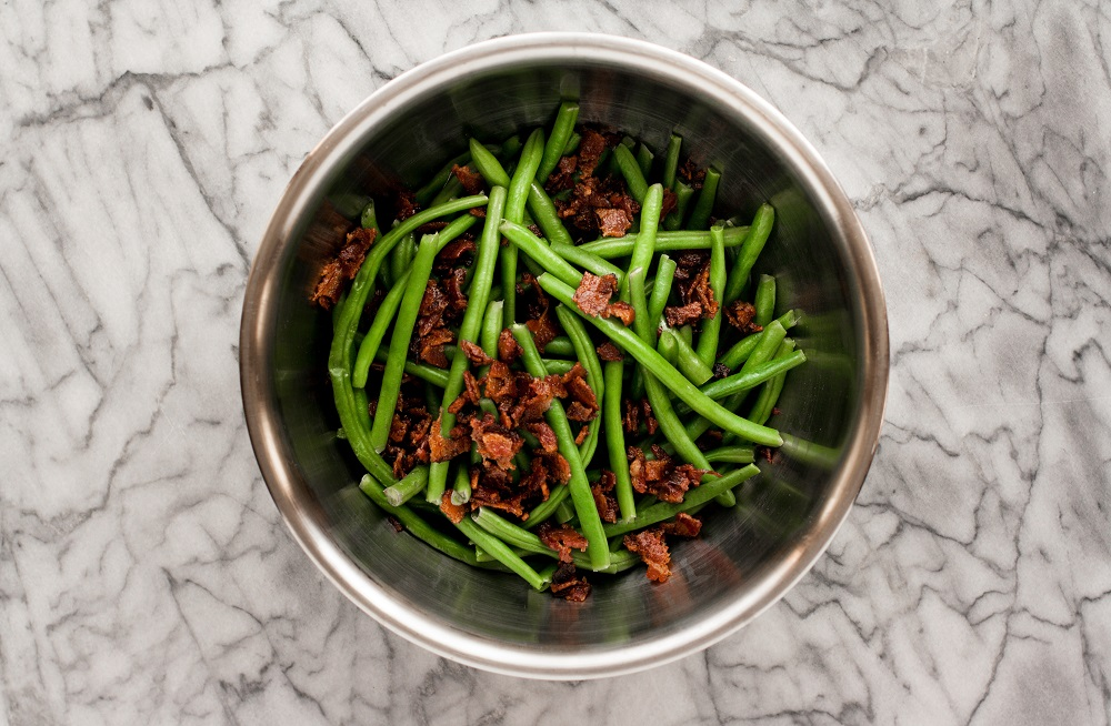mixture-of-green-beans-and-crumbled-bacon-on-marble-board-for-bacon-green-bean-casserole