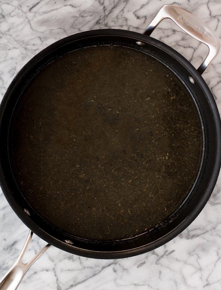 sauvignon blanc, reserved bacon fat, and dried parsley in a large pot