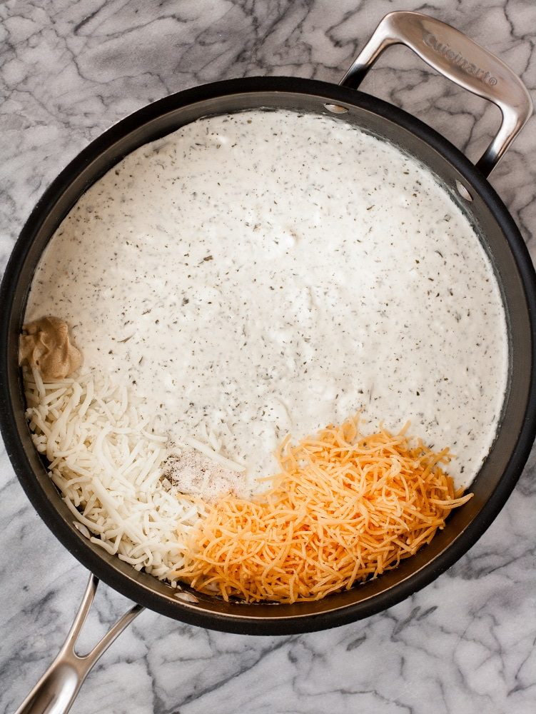 black-pot-with-cheese-sauce-and-shredded-cheese