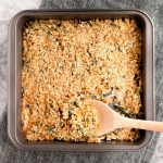 bacon-green-bean-casserole-in-baking-pan-on-marble-board-with-wooden-spoon