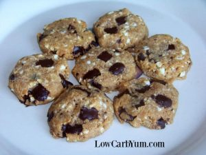 seven keto flourless peanut butter chocolate chip cookies on a plate
