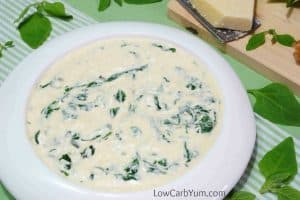 Keto Side Dish Recipes - a bowl of cheesy creamed spinach