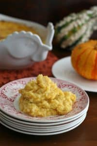 Butternut Squash & Cauliflower Casserole on a stack of ceramic saucers