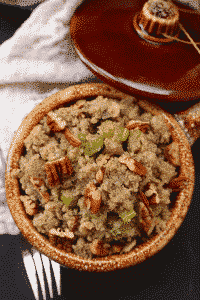 cauliflower rice stuffing in a clay pot with a fork