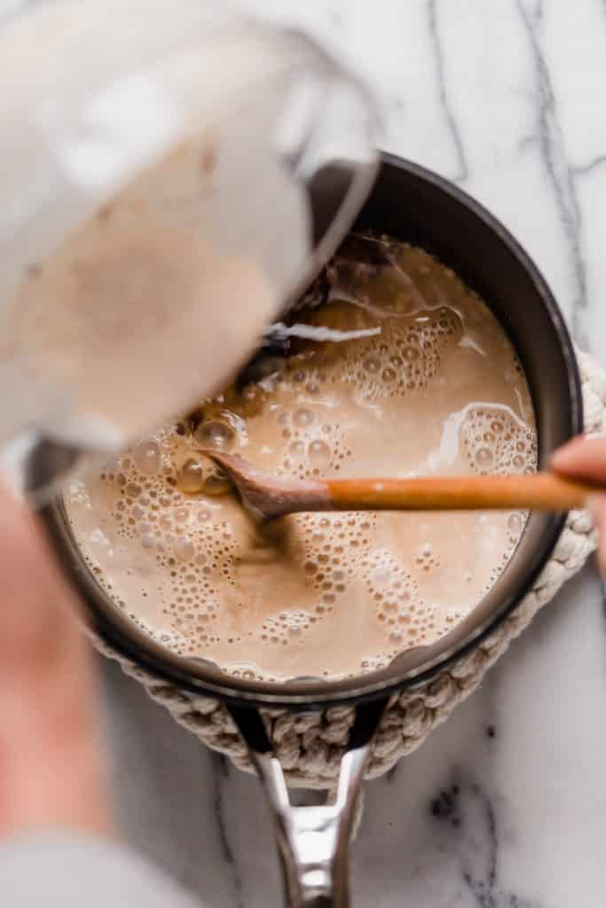 stir in espresso into the cinnamon dolce latte mixture in a small pot