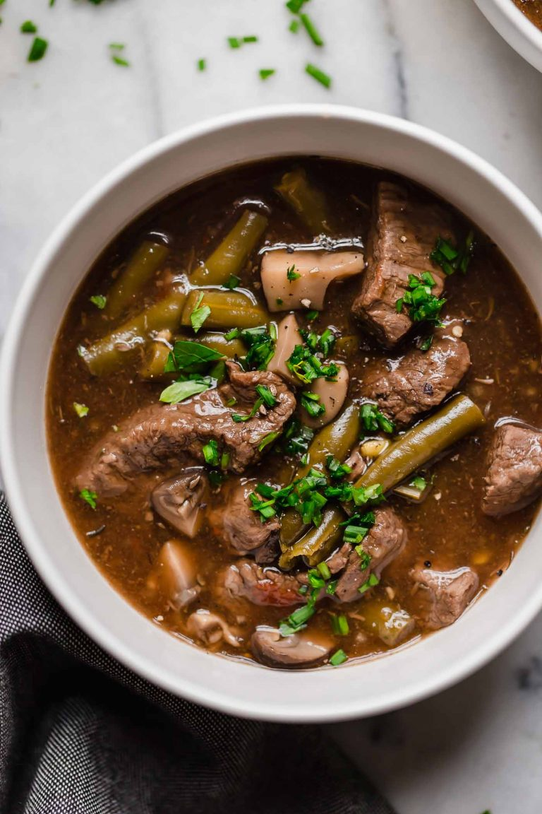 overhead shot of instant pot beef stew in a ceramic bowl