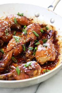 honey teriyaki drumsticks in a pan