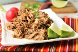 instant pot carnitas with lime wedges and turnips