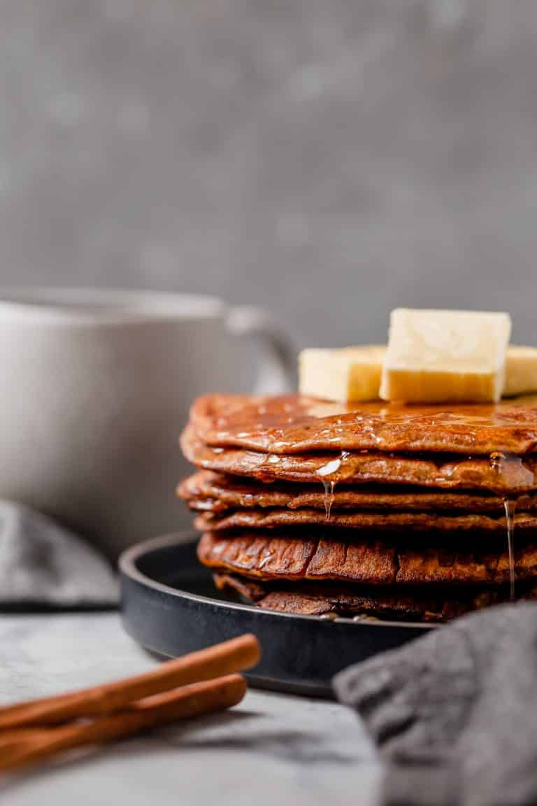 cooked flourless pumpkin spice pancakes served hot with Lakanto Maple-Flavored Syrup and butter