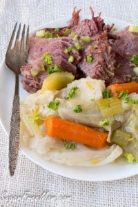 low carb corned beef and cabbage on plate with a fork