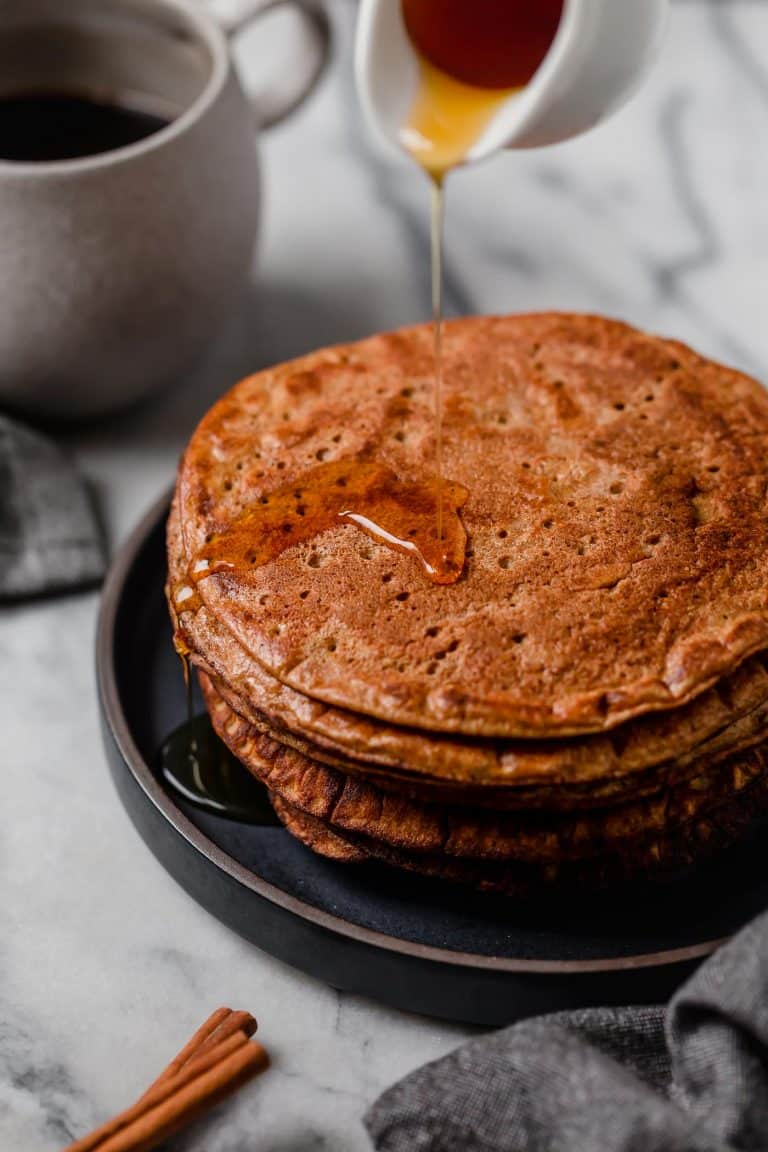 flourless pumpkin spice pancakes drizzled with lakanto maple-flavored syrup