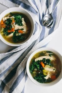 instant pot chicken soup with kale served in bowls with beside spoons