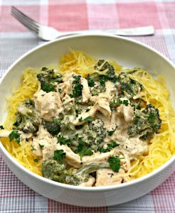 instant pot spaghetti squash chicken alfredo  served in a bowl beside a fork