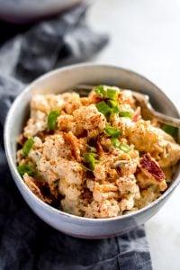 loaded cauliflower salad in ceramic bowl single shot
