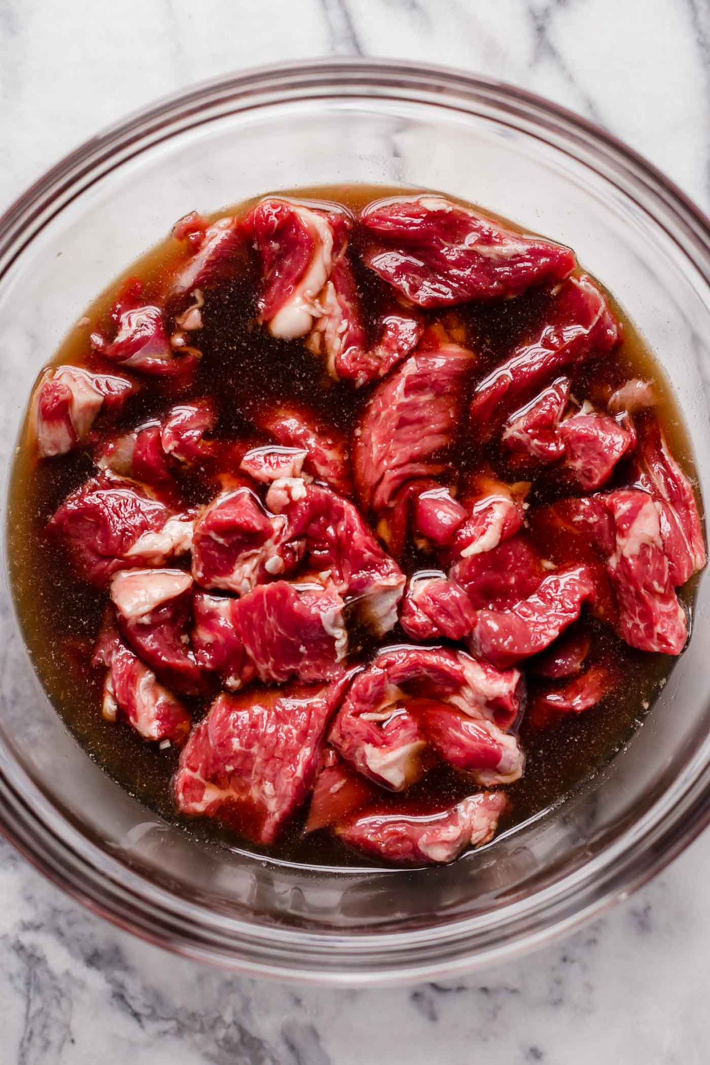 mix sliced chuck roast into beef broth, liquid aminos, ground ginger and monk fruit sweetener mixture