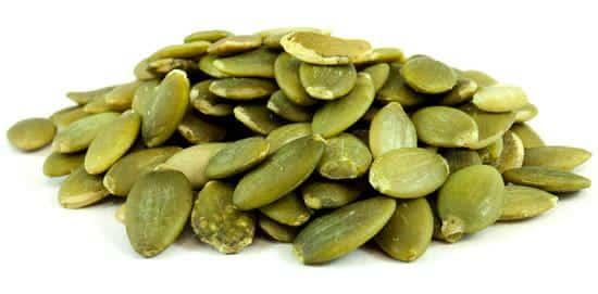 a pile of raw pumpkin seeds