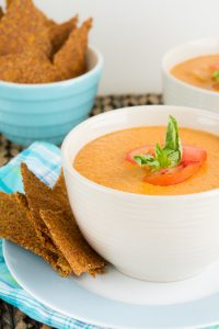 Bowl of Vegan Cream of Tomato Soup with low-carb crackers