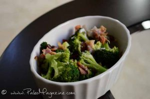 Broccoli Bacon Salad with Onions and coconut cream in a white dish