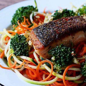 crispy salmon filet over spiralized vegetables