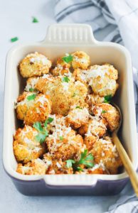 garlic parmesan roasted cauliflower in a dish
