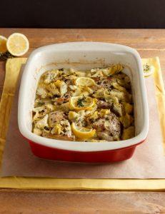 Red dish of Baked Lemon Artichoke Chicken Picatta
