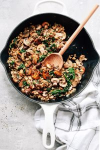 mushroom cauliflower rice skillet with wooden spoon