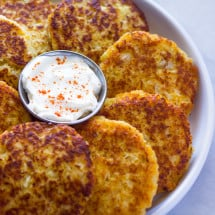 Multiple cauliflower cheddar fritters on a plate