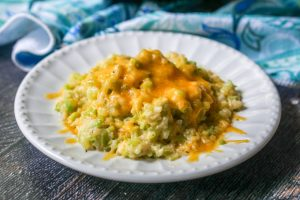 cheesy broccoli cauliflower rice on plate