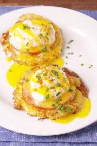 two servings of cauliflower benedict on a plate