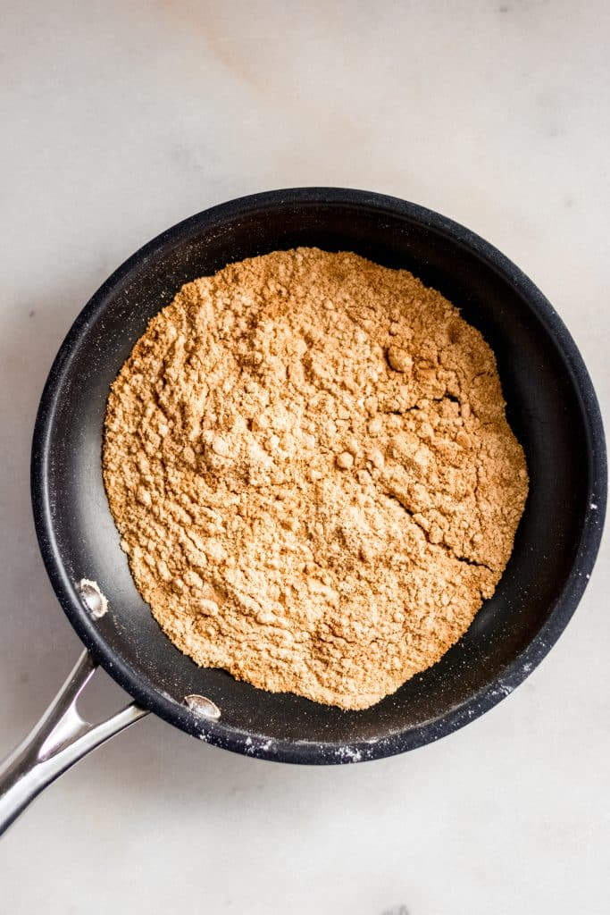 Coconut flour on a heated pan image