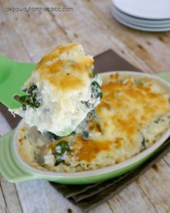 close up of low carb cauliflower casserole with spinach with dish in background
