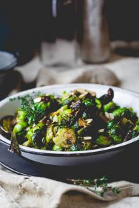 a bowl of roasted brussels sprouts with balsamic and thyme