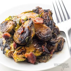 Crispy Pan Fried Brussels Spoutrs on a plate with a fork