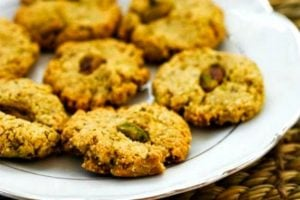 white plate of four ingredient keto pistachio cookies