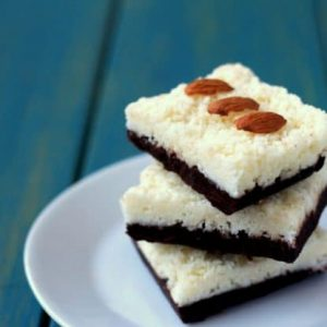 No Bake Almond Joy Bars stacked on a small white plate