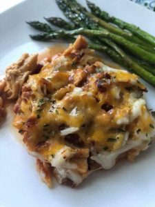 1 serving of BBQ chicken casserole on a plate with asparagus
