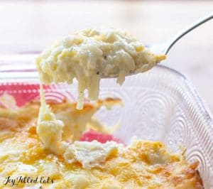 Cracker Barrel hash brown casserole being scooped from the dish